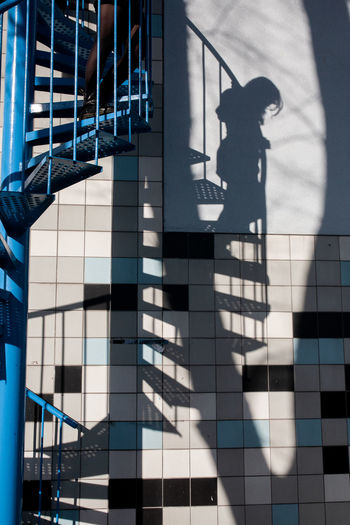 Shadow of person walking on modern building