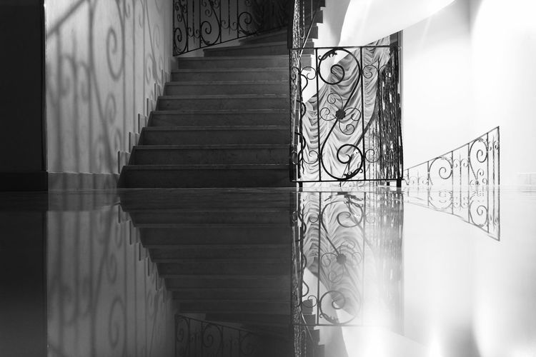 Reflection of steps on flooring in building