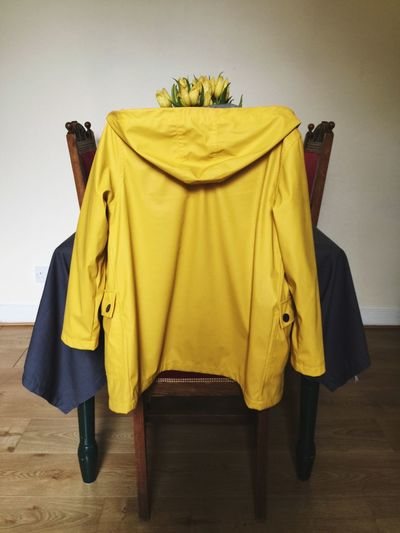 Close-up of hooded shirt on chair