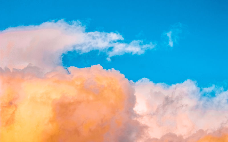 BLISS No People Nature Cloud - Sky Sky Scenics - Nature Beauty In Nature Cloudscape Multi Colored Blue Idyllic Orange Color Tranquility Backgrounds Tranquil Scene Outdoors Sunset Vibrant Color Low Angle View Fluffy Wind Softness Meteorology Bright