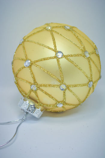 Close-Up Of Christmas Bauble Over White Background