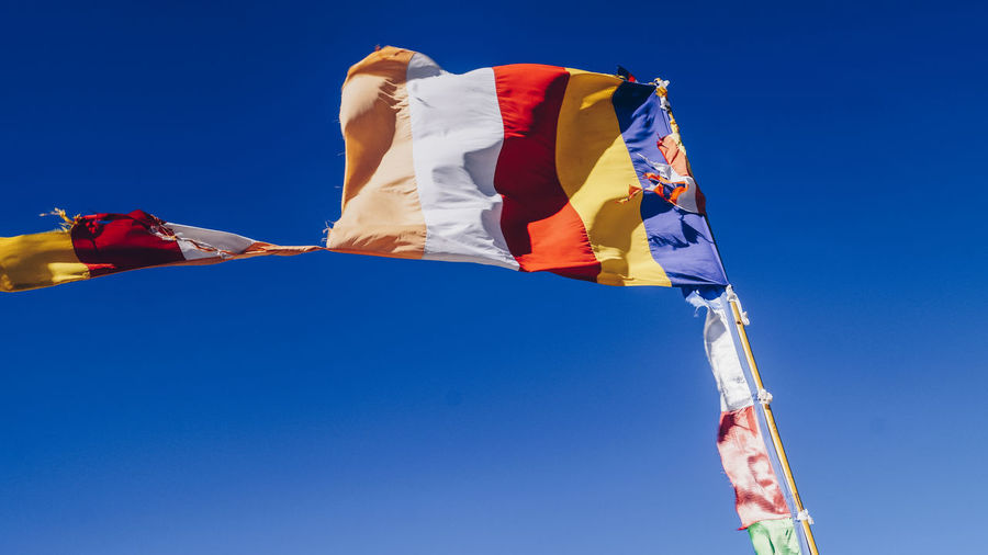 Prayer flag looking absolutley beautiful. Flag Blue Clear Sky Low Angle View Sky Day Outdoors The Great Outdoors - 2017 EyeEm Awards Travel Destinations Travel Photography Travel Traveling Travelong EyeEm Best Shots Eyeemphotography Eyemphotography Live For The Story Backgrounds Low Angle View EyeEmNewHere Place Of Heart EyeEm Selects Paint The Town Yellow Been There. Connected By Travel