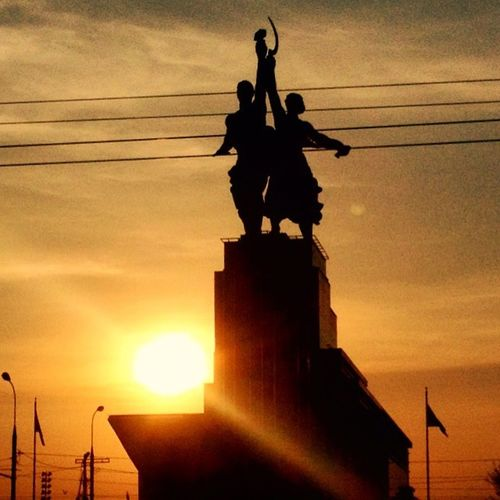 Soviet Union ghosts. 'Rabochiy i Kolkhoznitsa' monument, VDNH. Low Angle View Monument Monument Silhouette Moscow Orange Color Rabochiy I Kolkhoznitsa Russia Silhouette Sky Soviet Architecture Soviet Art Soviet Era Soviet Union Sun Sunbeam Sunset VDNH Worker And Kolkhoz Woman