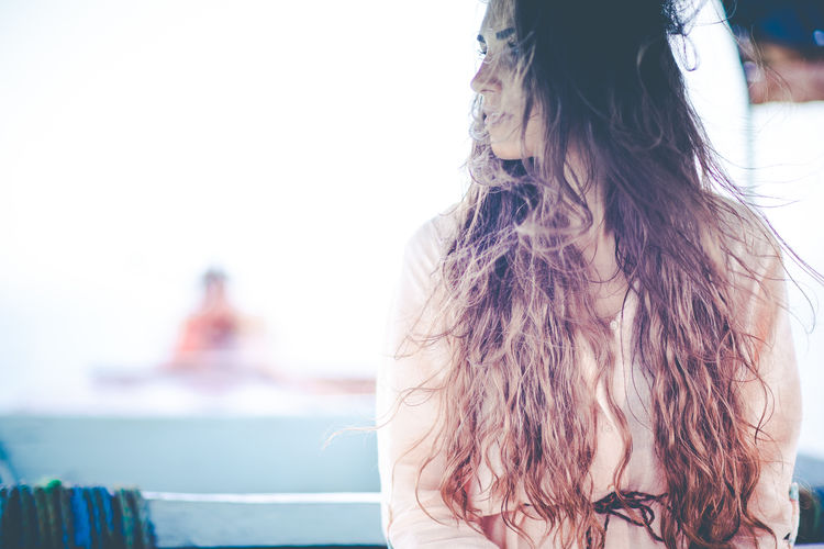 Thoughtful Young Woman Looking Away On Boat At Sea