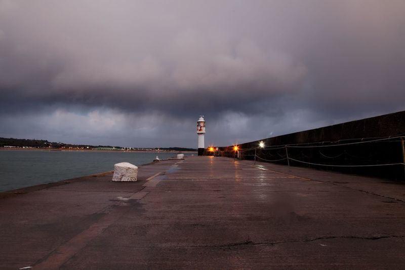 Light house at the mouth of Penzance harbour. Cornwall Lighthouse Water Sky Cloud - Sky Built Structure Architecture Sea Building Exterior Outdoors Scenics No People Illuminated Penzance  Cornwall