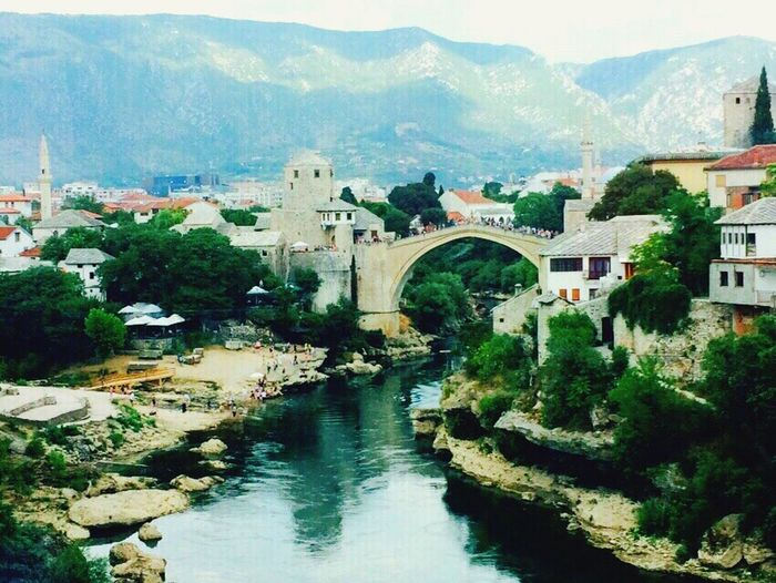 Architecture Built Structure Water Building Exterior River Connection Bridge - Man Made Structure House Mountain Residential Structure High Angle View Waterfront Town Residential Building Travel Destinations Residential District Riverbank Arch Bridge Scenics Bridge Bosnahersek Mostar Bosnia And Herzegovina