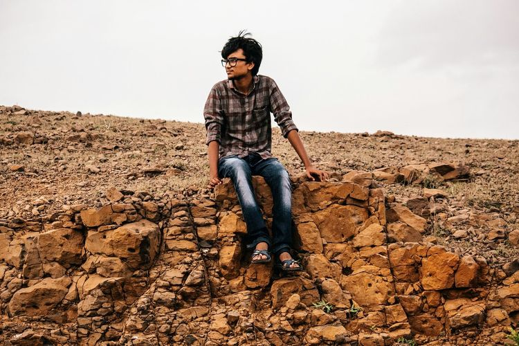Full length of young man on rock