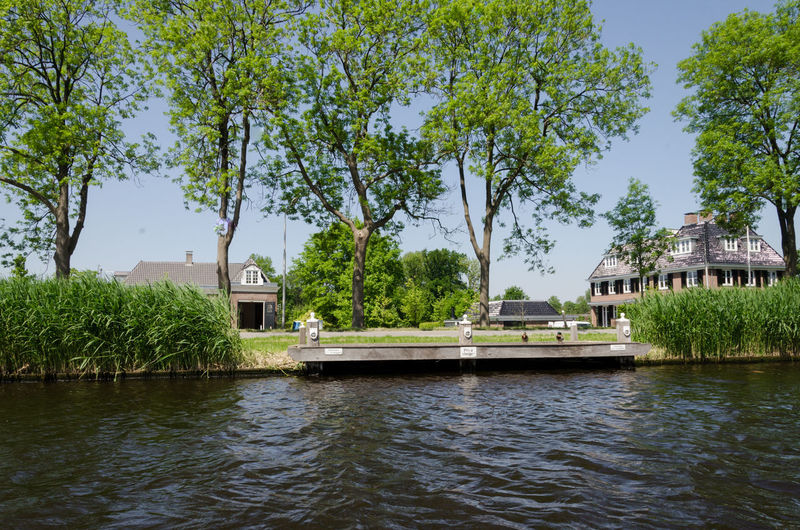 Old Canal houses on the Amstel River Amsterdam Amstel Amsterdam Amsterdam Canal Amsterdam City Architecture Dogs Houses Abcoude Amsterdamcity Amsterdamse Grachten Boat Boats Canal Dog Old Houses Oude Kerk Water Water_collection Waterfront