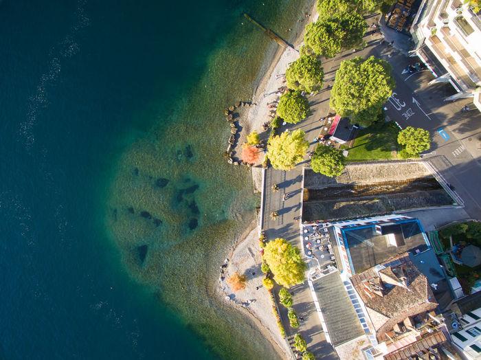 Aerial view of coastline by buildings