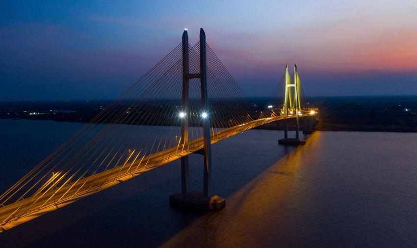 Illuminated suspension bridge over sea