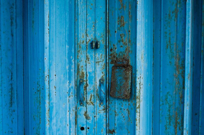 Full Frame Shot Of Blue Metallic Door