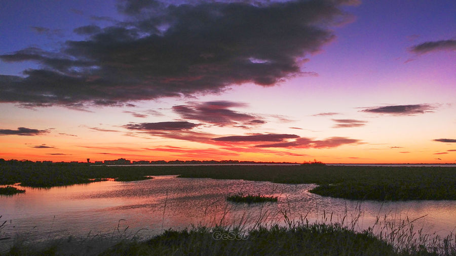 Sky Sunset Scenics - Nature Beauty In Nature Tranquility Tranquil Scene Water Cloud - Sky Lake Plant Grass No People Reflection Nature Idyllic Non-urban Scene Environment Landscape Orange Color Outdoors