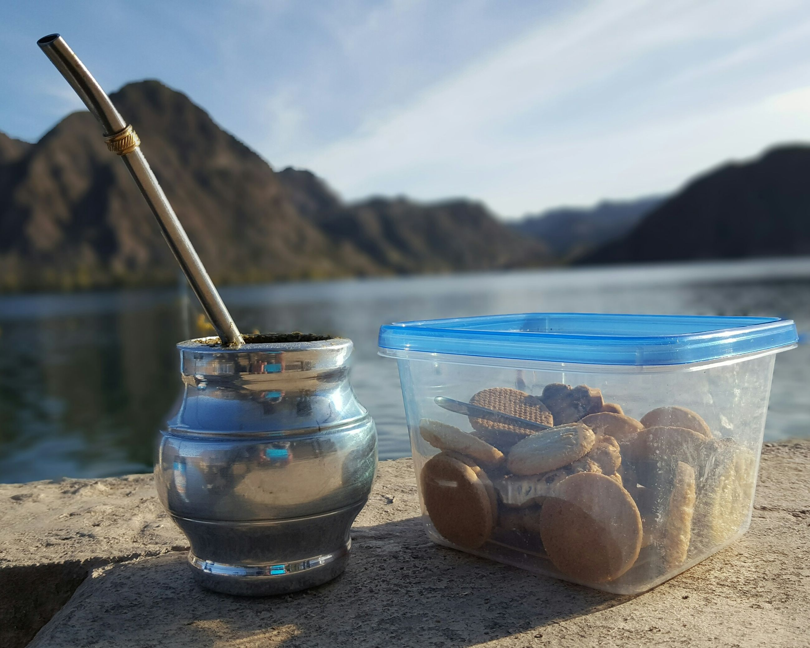 mountain, drinking straw, food and drink, focus on foreground, jar, no people, outdoors, day, drink, freshness, sky, beach, healthy eating, nature, water, food, beauty in nature, close-up