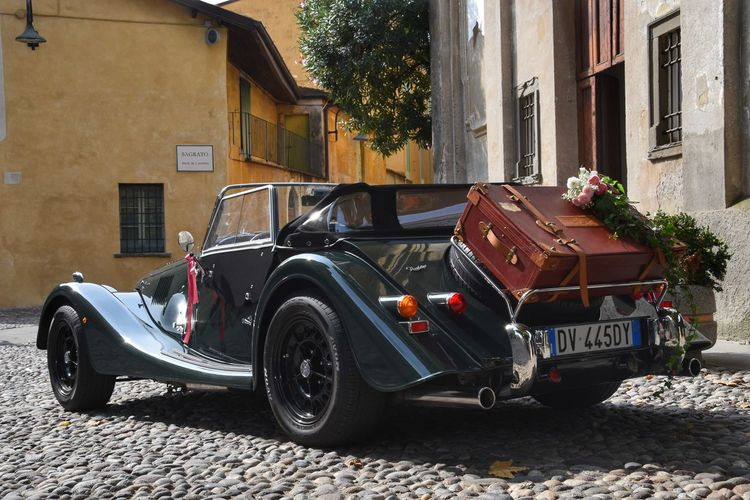 A New Beginning Driving Away Church Parvis Cobblestone Street Flower Bouquet  Roadster Roses Suitcase Retro Styled New Life Green Car Wedding Day Wedding Photography Autumn Light EyeEm Selects A New Beginning Car Vintage Car Car Point Of View Mode Of Transport Collector's Car