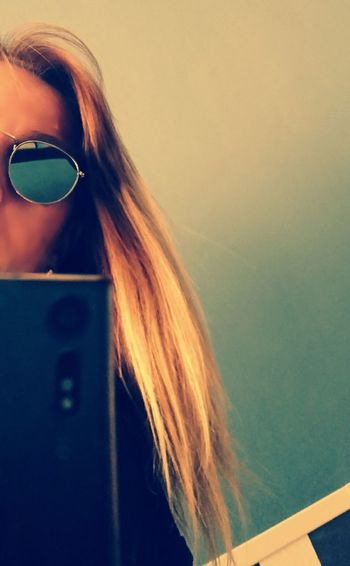 Young Women Women Beautiful Woman Blond Hair Technology Long Hair Human Hair Close-up Sunglasses