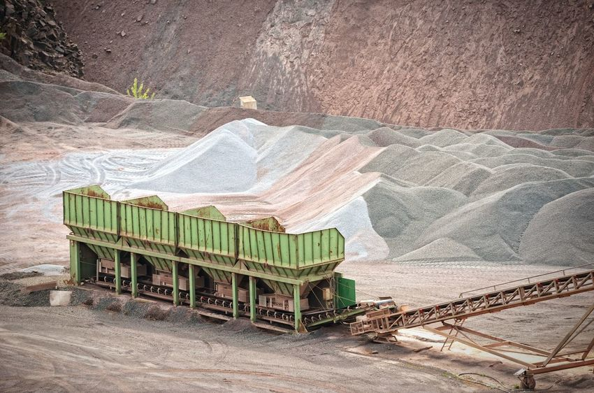 production of road construction matetial. mining industry. Excuvator Bagger Open Pit Mine Mining Mine Bergbau Pit Quarry Steinbruch Steinbrecher Stone Crusher