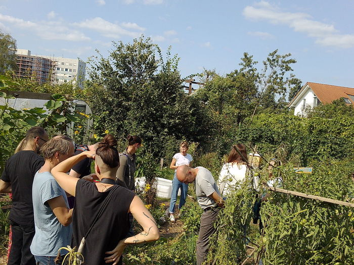 Group of people against plants