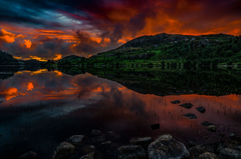 There was a Time a quiet Time When the sun went down, beautiful, powerful, And then - all was calm in my soul Beauty In Nature Cloud - Sky Lake Land Mountain Nature No People Non-urban Scene Orange Color Outdoors Reflection Rock Scenics - Nature Sky Solid Sunset Tranquil Scene Tranquility Water