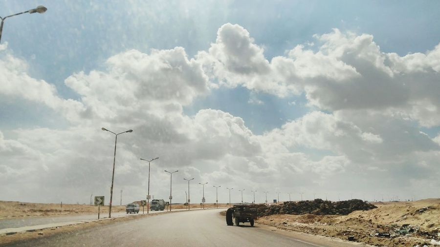Everydayegypt Scenics Beauty In Nature Cloudy Day Telephone Line Sky Cloud - Sky Electricity Pylon Power Cable Storm Cloud High Voltage Sign Empty Road Countryside vanishing point