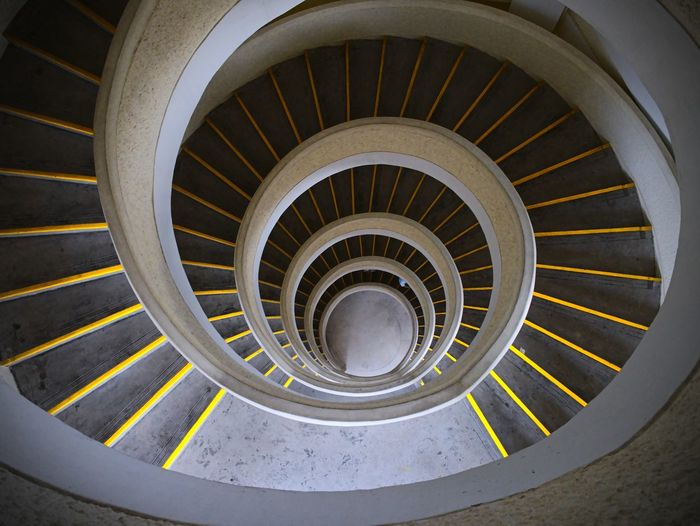 Steps And Staircases Staircase Architecture Spiral Spiral Staircase Built Structure Railing Design Shape High Angle View Diminishing Perspective Directly Above Indoors  Pattern Geometric Shape Circle No People Day Building Concentric Building Feature