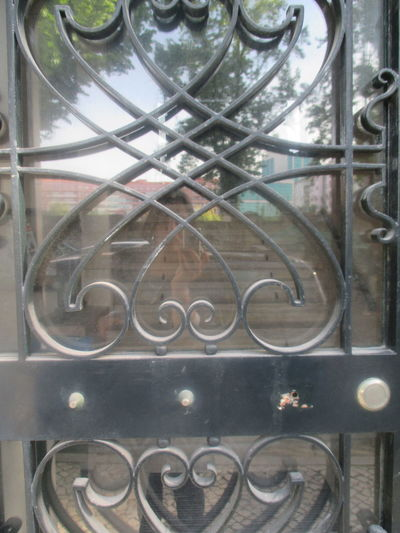 Artistic Gate Beautiful Door Beautiful Old Gate Detail From A Gate Glass And Iron Old Gate Romantic Gate #closed Gate #detail From The Gate #gate #kitch #ornaments #reflection Architecture Close-up Day Detail Door Aart Heart-like Ornaments Indoors  Metal Metal Gate No People Reflection Of The Tree Wrought Iron