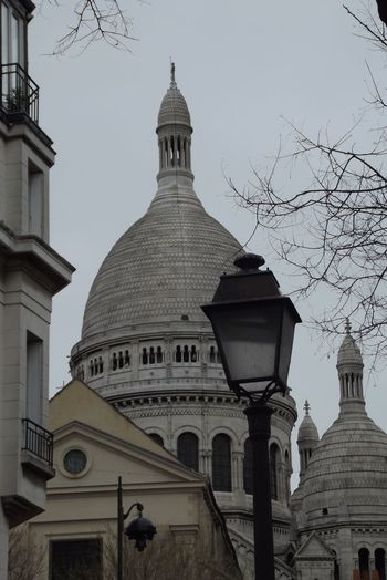 Paris Architecture Bare Tree Building Exterior Built Structure City Clear Sky Day Dome History Low Angle View Monmartre No People Outdoors Place Of Worship Religion Sacre Couer Sky Spirituality Travel Destinations Tree