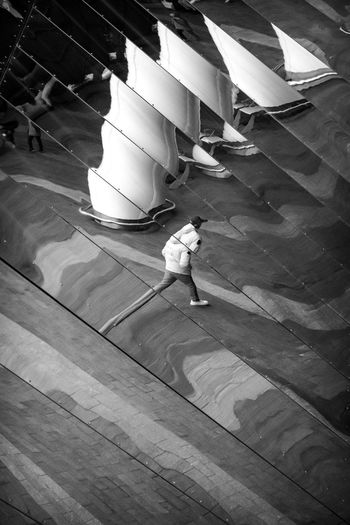 High angle view of people walking on wooden floor