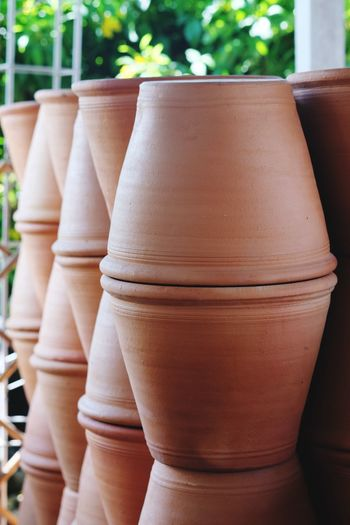 Close-up of terracotta pots for sale at market