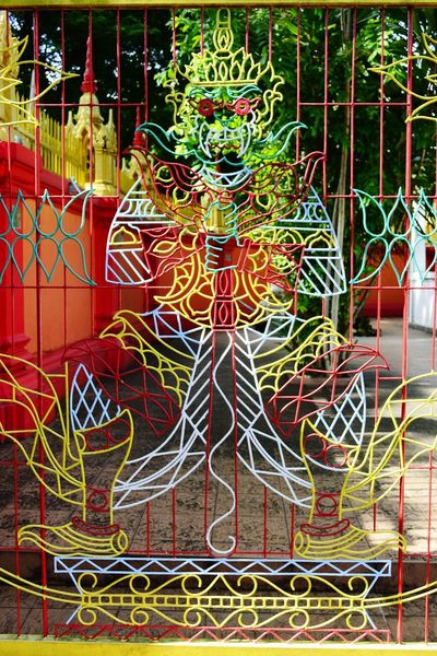 """Fancy Creature Idol in metal Gate."" Fancy Creature No People Outdoors Multi Colored Strange Place Of Worship Sculpture Spirituality Religion Nawfal Still Life Photography Close-up Statue Human Representation Pattern Penang, Malaysia"