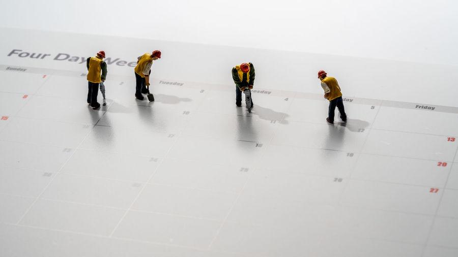 Group of people walking on tiled floor