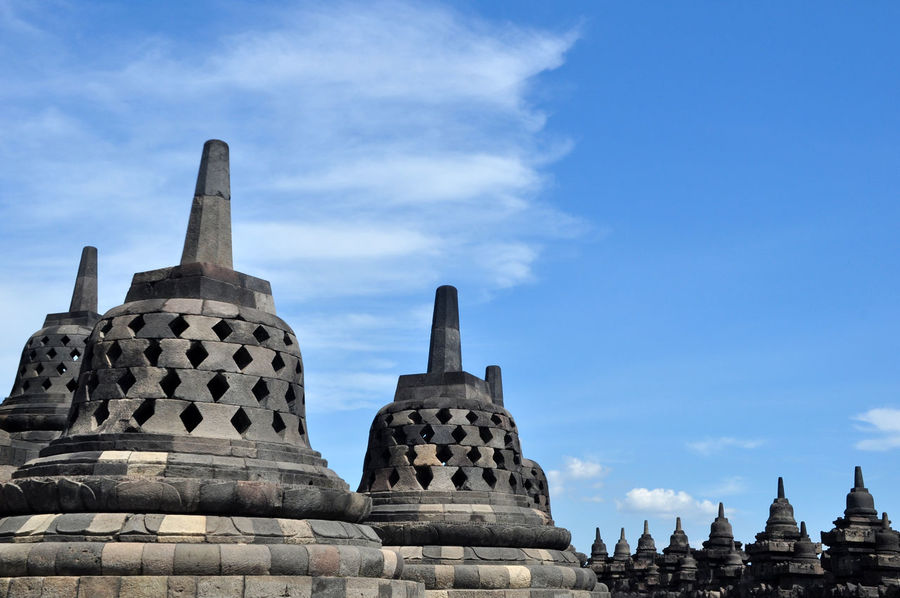 Stupa of Borobudur Temple - Indonesia Ancient Civilization Architecture Architecture Blue Borobudur Borobudur Temple Buddhism Buddies Building Building Exterior Built Structure Cloud - Sky Day History INDONESIA No People Outdoors Place Of Worship Religion Sky Sky And Clouds Spirituality Statue Stupa Travel Destinations
