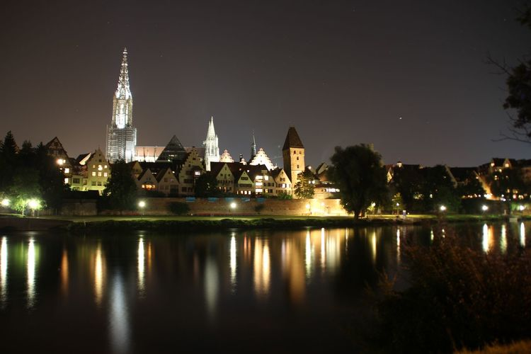 Ulm EyeEm Selects The Traveler - 2018 EyeEm Awards Tourism Politics And Government City Cityscape Urban Skyline Illuminated Water Clock Tower Tree Business Finance And Industry River Cathedral Famous Place Tourist Attraction  Tower Riverbank Office Building Tall - High Place Of Worship Spire  International Landmark HUAWEI Photo Award: After Dark