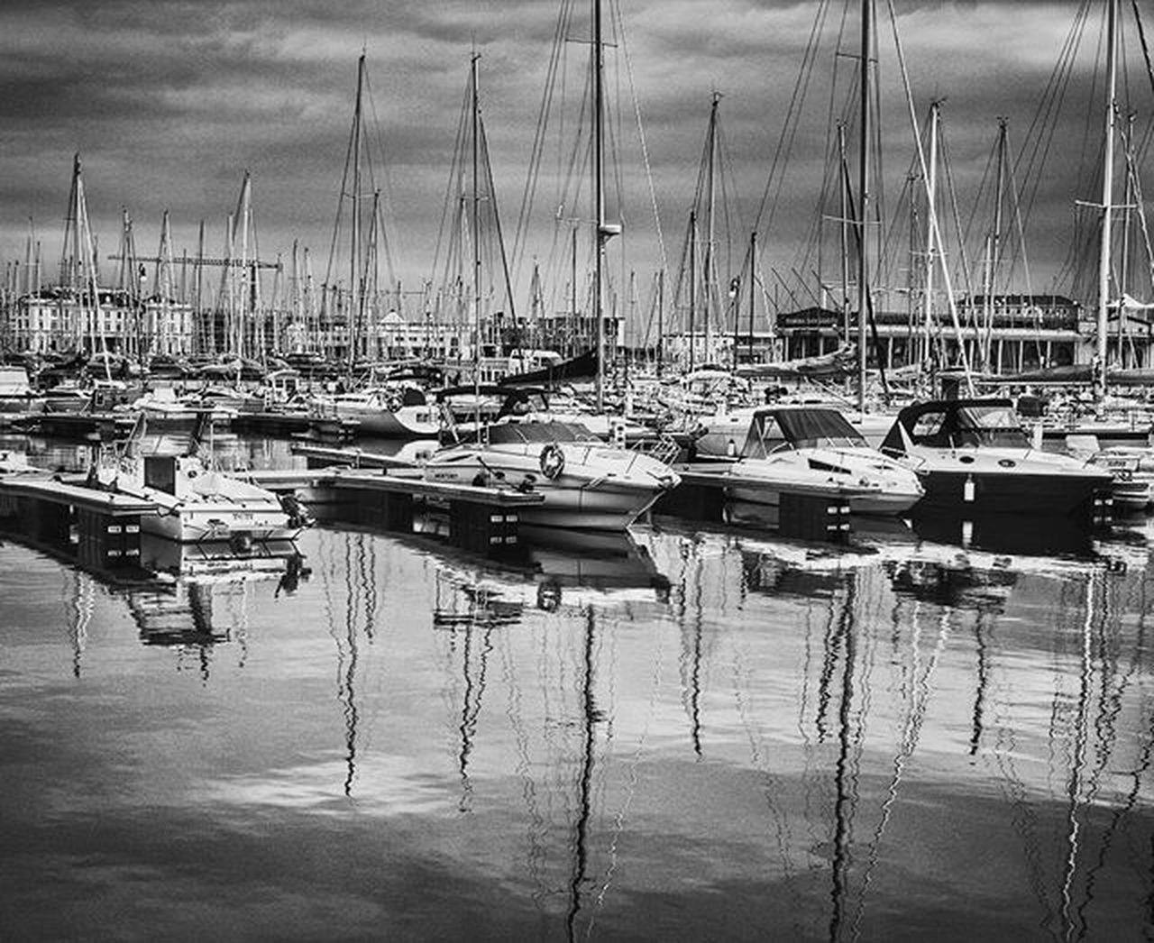 nautical vessel, moored, transportation, mode of transport, reflection, water, harbor, boat, no people, mast, day, large group of objects, outdoors, sailboat, marina, yacht, tranquility, sky, sea, nature