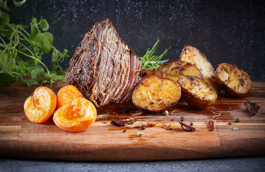 Beef meat roasted potato and apricot rosemary Apricot Apricots Black Background EyeEmNewHere Herbs Rosemary Beef Meat Close-up Cutting Board Food Food And Drink Pork Meat Potatoes Potatoes With Rosemary Roasted Meat Wood - Material