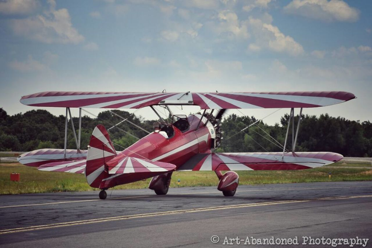 transportation, air vehicle, airplane, sky, airport runway, day, outdoors, flag, mode of transport, no people