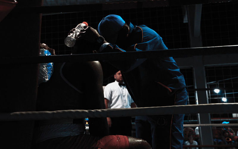 Coach Instructing Boxer In Ring