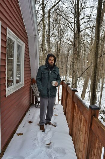 Warm Clothing Full Length Tree Snow Winter Cold Temperature Standing Portrait Front View Architecture Hands In Pockets Moments Of Happiness