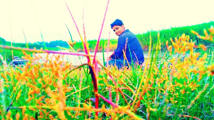 One Man Only Only Men One Person Adults Only Grass Adult Field Growth Green Color People Agriculture Outdoors Nature Rural Scene Farmer Men Day Working Full Length Multi Colored mobile photography sonu kumar Mobile Photography Perspectives On Nature