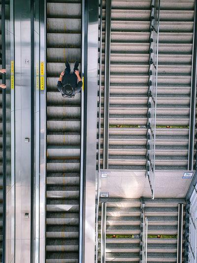 High angle view of man on escalator