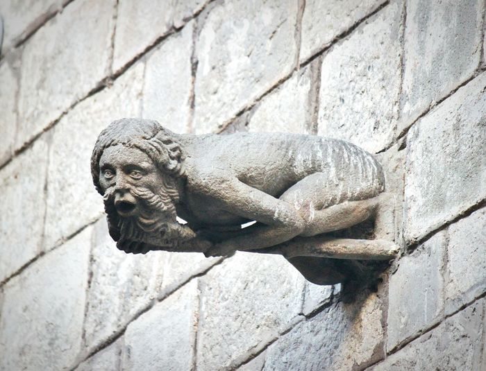 Low Angle View Of Gargoyle Statue On Wall