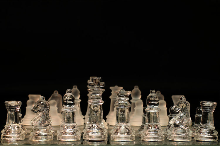 Leisure Games Chess Board Game Black Background Game Copy Space Glass - Material Chess Board Arrangement Chess Piece Large Group Of Objects Indoors  Strategy Studio Shot Competition Relaxation No People Order Leisure Activity Still Life Pawn - Chess Piece King - Chess Piece Queen - Chess Piece Knight - Chess Piece Sport