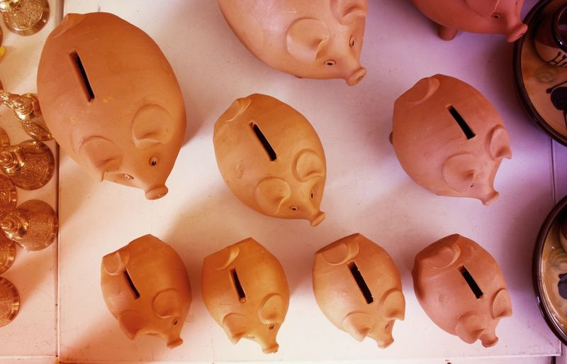 Directly Above Shot Of Piggy Banks On Table