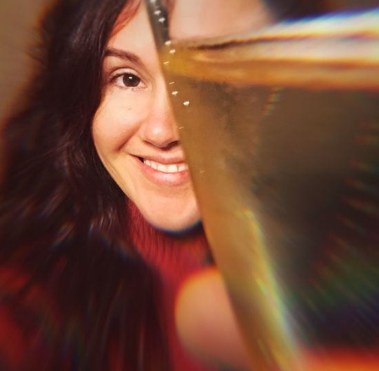 Salud Cheers Good Cheer Face Drink Long Hair Brunette Woman New Years Eve Celebration Celebrate Holiday Drink Alcohol Champagne Smiling Happiness One Person Cheerful Indoors  Close-up Young Women