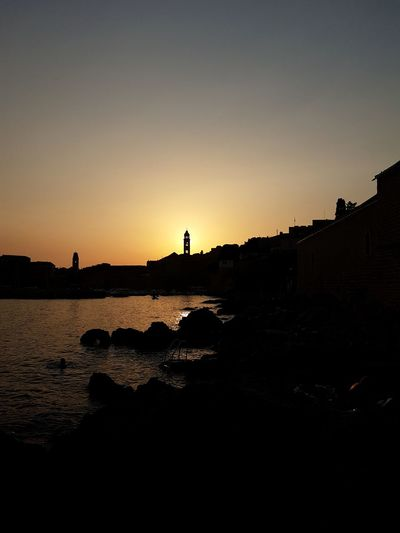 Sun through the bell tower in Dubrovnik. Sky Day Dubrovnik Croatia Outdoors Photography Nature Clear Sky Sunlight Sunset Cityscape City Landscape No People Beautiful Harbour View Water Adriatic Sea Beauty In Nature Boat Waves, Ocean, Nature Beauty Of Nature Tranquility Walls Oldtown Oldcity