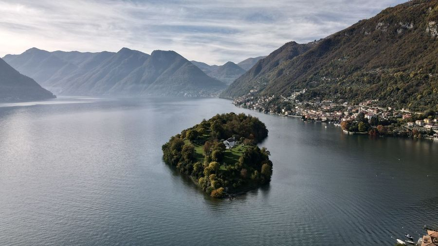 Scenic view of como lake  omacina island and mountains against sky