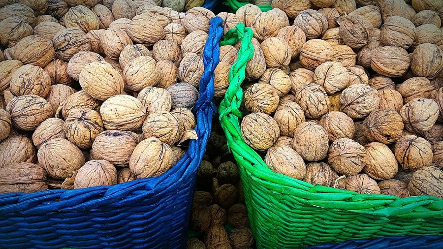 Close-up of walnuts in wicker baskets for sale