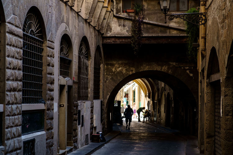 An old arcade, Rome, Italy. Rome Arcade Arch Arched Architecture Building Building Exterior Built Structure Day Direction Fujifilm Fujifilm_xseries Full Length Group Of People Italy Leisure Activity Lifestyles Men Old Outdoors People Real People The Way Forward Walking