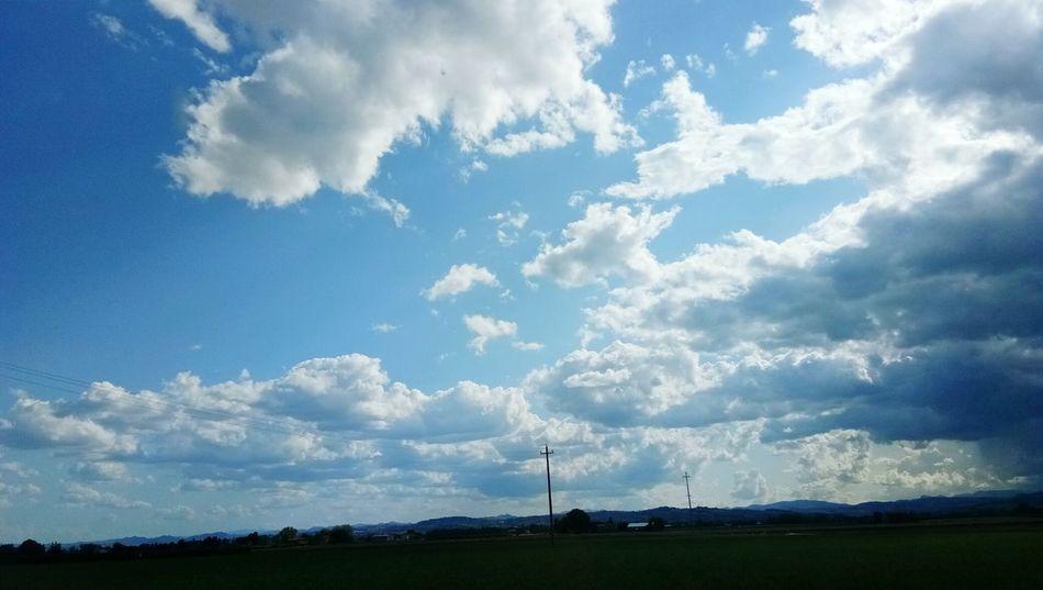 Sky blue Cloud - Sky Day Sky No People Field Nature Tree Rural Scene Landscape Storm Cloud Outdoors Power In Nature Wind Power Beauty In Nature Women
