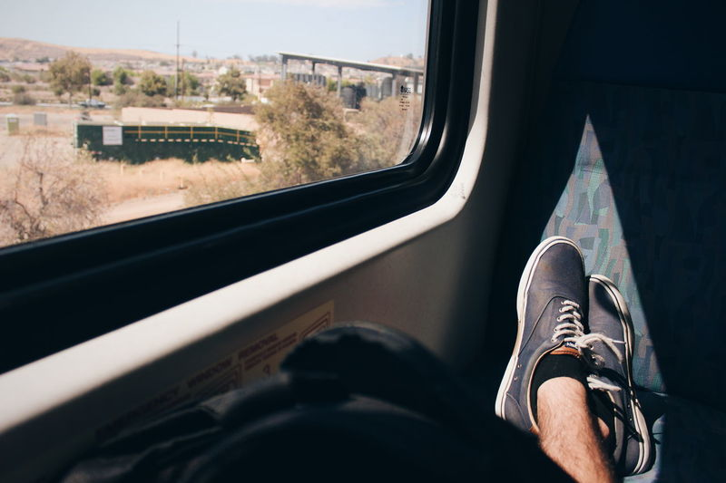 Feetured. Transportation Travel Train - Vehicle Journey Shoe Window People Day Outdoors Light Relaxing Non-urban Scene Light And Shadow Shadows Desert Human Leg Packed Up Been There.