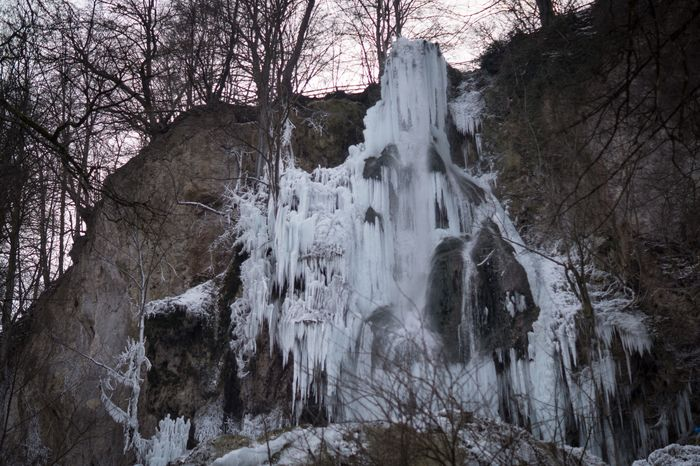 Frozen Waterfall III SonyAlpha58 Gefroren Wasserfall Frozen Nature Waterfall Beauty In Nature Forest Winter Tree Scenics Cold Temperature Tranquility Snow No People Water Landscape Tranquil Scene Outdoors Motion Bare Tree Travel Destinations Day Sky